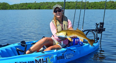 Article image - 2016 Top Gun Christina Weber with a redfish.